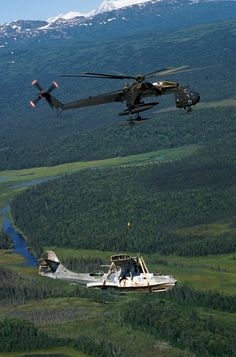 An Alaska Army National Guard CH-54B Tahre airlifts an OA-10 PBY Catalina flying boat while departing Lake Clark Pass during a recovery operation.  The historic aircraft was abandoned by the Air Force after engine trouble forced it down at Dago Lake on September 30, 1947.  Members of the Alaskan Aviation Heritage Museum, initiators of the recovery operation, plan to restore the aircraft and have it flying again sometime in the early 1990s.