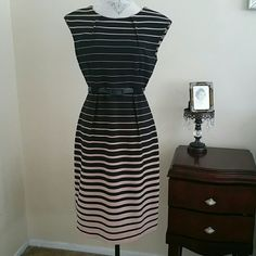 Black and Tan Stripes Dress Excellent Condition  Only worn 3 times 95% Polyester  5% Spandex Connected  Dresses Midi