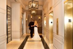 Bride and groom in the lobby hallway at The Madison hotel, a historic wedding venue in Washington, DC.