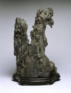 Scholar's Rock      Medium: Limestone     Dates: 18th century     Dynasty: Qing Dynasty     Dimensions: 13 1/2 x 8 3/4 x 6 3/4 in. (34.3 x 22.2 x 17.1 cm) Base: 1 1/4 x 8 3/4 x 13 1/2 in. (3.2 x 22.2 x 34.3 cm)  (show scale)     Collections:Asian Art     Accession Number: 2002.37     Credit Line: Gift of Alastair Bradley Martin     Caption: Scholar's Rock, 18th century. Limestone, 34.3 x 22.2 x 17.1 cm). Brooklyn Museum,  Gift of Alastair Bradley Martin, 2002.37.