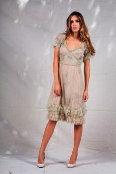 Bring back the days of silent film stars in this sweet 1920s-style party dress. This flirty dress grazes your knees and frees your legs for dancing the Charleston. Ruffles at the hem complete the look.  http://www.natayadresses.com/323-thickbox/sweet-1920-style-party-dress.jpg