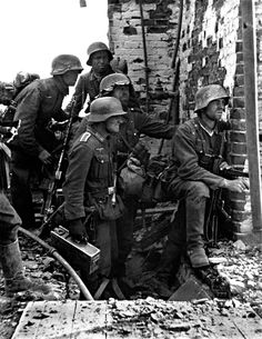 German Infantrymen pause in the ruins during heavy fighting with Soviet forces during he Battle of Stalingrad. Stalingrad (Volgograd), Volgograd Oblast, Russia, Soviet Union. September 1942.