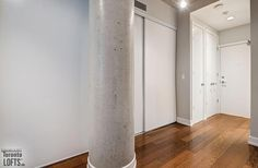 66 Portland Lofts-66 Portland St #206 | Ideal 530 sf 1 bedroom & 1 bath loft for 1st time buyers/investors or a pied-a-terre. Features 10 ft high exposed concrete ceilings, dark laminate floors & 2 large fluted concrete columns. | More info here: torontolofts.ca/66-portland-lofts-lofts-for-sale/66-portland-st-206 Concrete Column, Concrete Ceiling, Exposed Concrete, Dark Laminate Floors, High Windows, Window Wall, Lofts, Open Concept, Columns