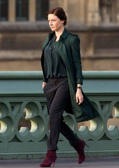 "Rebecca Ferguson Green Cotton Trench Coat - Mission Impossible: Rogue Nation. I'm obsessed with this ""hero coat."" The pleated back looked amazing on Ilsa Faust in the seminal fight scene. It's a ""knock off"" but there is a 30 day return policy if the quality is not up to my standards."
