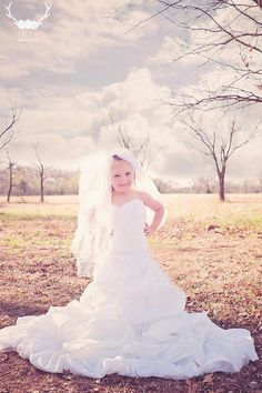 Daughter in moms wedding dress photo