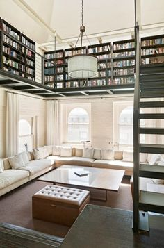 loft area of book shelves and downstairs area of comfy couches and windows.  Luxurious.