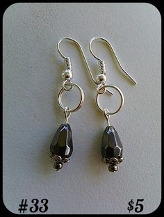 This is a silver fish hook earring. Please feel free to comment or message me if interested in purchasing this item! Thank you :)