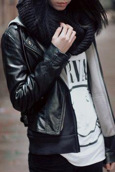 Black leather jacket layered casually