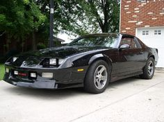 1989 Camaro.  Mine was forrest green with a gold flake paint.  V8 engine.  So fast...I wrecked it.