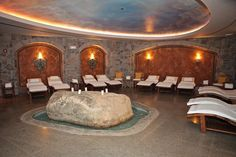 Resting area with foot bath around the rock, Mirbeau Inn & Spa at The Pinehills