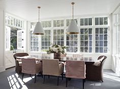 Light filled breakfast room with white beadboard ceiling and grey natural stone tiled floors
