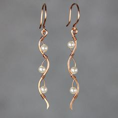 """$25.94, I choose 1 1/4"""" silver, with red coral beads - AMES  (Copper pearl)Ocean wavy line long linear wiring earrings"""