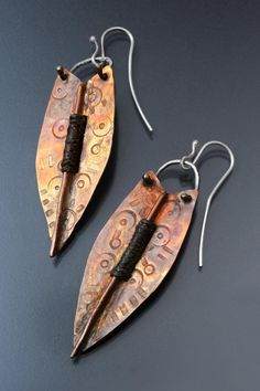 Fold-formed shield earrings... LOVE this artist's work; it's simply amazing.