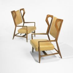 Gio Ponti, Walnut, Leather and Brass Armchairs for ISA, 1952.