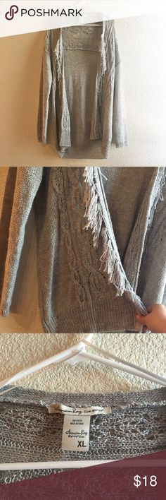 American Rag Gray Open Knit Cardigan Open Cardigan sweater by American Rag with Fringe. On the longer side perfect for fall 💕🍂 American Rag Sweaters Cardigans