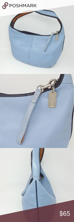 """COACH Ergo Classic Pale Blue Leather Hobo Bag COACH Pale Blue Leather Hobo Bag  Pale blue with navy blue and tan leather trim.  Gray Coach logo interior and Coach Creed.  Bag is PRE-OWNED and has minor scuffs and marks.   See all photos.  Photos are of actual product and not stock photos.  The body of the bag is 16"""" wide by 11"""" tall.  The strap section is 17.5"""" long. Coach Bags Hobos"""