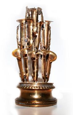 His bronze sculptures speak to Arman's fascination with form, music, and rhythm and his exploration of culture. The most recognizable of his works are the Arman Violins. French Sculptor, Whole Image, Gcse Art, Bronze Sculpture, American Artists, Figurative Art, Les Oeuvres, Candle Holders, Objects