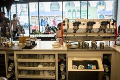 Espresso bar layout- like cups under the counter, good utilization of space