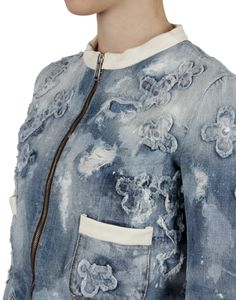 DENIM FLOWER COCO JACKET: Bold designed details set Dsquared2's hybrid jacket-shirt apart. Soft distressed denim blooms with appliqued flowers and contrasting exposed zip. The cropped unlined shape perfectly pairs with this season's high waist shorts.