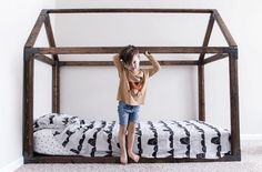 """image via There is one thing all parents have in common. The inevitable switch from a crib to """"big kid"""" bed! Typically parents start to think about this when their little one begins climb…"""