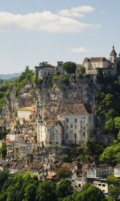 Rocamadour, Lot, Midi-Pyrenees, France We had lunch at a cafe and my husband climbed the low wall and dangled his legs over the cliff edge.