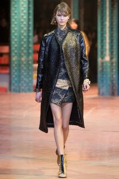 #PFW #FW2013 #RTW  I like this royal blue/gold look with the oversize coat and the short dress under again overlapping at hem.