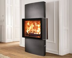 Only available from Kernow Fires, on display in our Wadebridge showroom, the Austroflamm Lounge.    #austroflamm #stove #fire #fireplace #exclusive #design #interior #interiordesign #house #home Biomass Boiler, Showroom, Stove, Lounge, Home Appliances, Interior Design, Wood, Home Decor, Airport Lounge