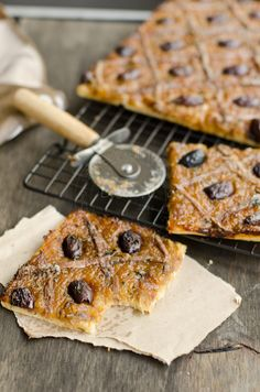 Pissaladiere ~ is a dish which originated from Nice in Southern France. The dough is usually a bread dough with traditional topping consists of caramelised onions, olives, garlic and anchovies