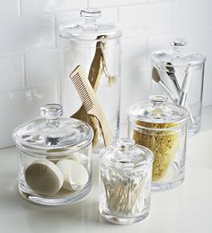 Simple bathroom storage with a retro feel. Handmade glass canisters with nesting lids update a classic apothecary look.