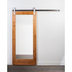 Provide privacy without a traditional door swinging into the way with this barn-style door. The integrated mirror makes this bard door ideal for a bathroom in a master bedroom. A durable steel track holds this door securely and lets it slide freely back and forth for easy access to both rooms.
