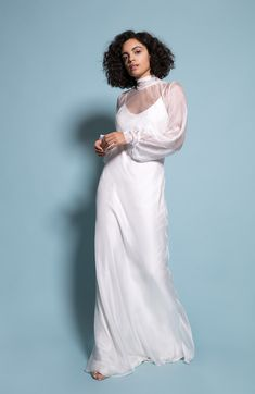 Floor length Slip underdress with chiffon overlay dress Button detail on sleeves Tie neck Model is wearing 4 inch heels and is a size 10 wearing a size S Ivory Bridesmaid Dresses, Wedding Dresses, White Chiffon, Center Stage, Button Dress, Mix N Match, New Dress, White Dress, Glamour