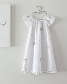 This is an original and Exclusive Chasing Mini dress made be me in my studio. MADE TO ORDER in sizes 6-12mths and 1-2yrs. My production time at the moment is 2-3 weeks.  This is such an unique dress made in a beautiful vintage cotton organdy with a grey spot cotton underlay and finished with cotton pompoms.The fabric is beautiful with little embroidered ladybugs.  I take time and care when making my outfits and each one is professionally finished and made of quality eco friendly natural…