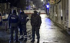 Three people were arrested in a Brussels counter-terrorism raid over the attacks in Paris, local media reported.