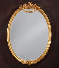 oval mirror | oval Louis XVI style carved wood wall mirror with antique gold leaf finish and beveled glass; made in Italy; Louis XVI mirror; Louis XVI style