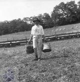 Herdsman with 'geleta' for milking the sheep.  Valach s geletami nadojeného ovčieho mlieka. Klenovec, okr. Rimavská Sobota. Archív negatívov Ústav etnológie SAV. F. Hideg, 1960.