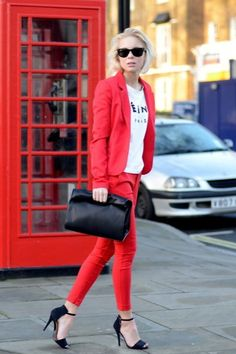 A t-shirt and stiletto sandals dress down a pantsuit for an edgier off-the-clock look. #DayToNight