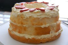 Pineapple Lush Cake  --  quick and easy recipe that uses store bought angel food cake, filling made with undrained canned pineapple, instant vanilla pudding mix, and Cool Whip, and garnished with fresh strawberries.