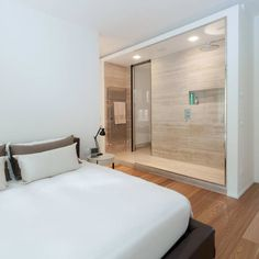 CASA L+L: Camera da letto in stile in stile Minimalista di Studio Associato Casiraghi