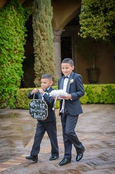 "Ring Bearers walk down the aisle with, ""Hey Uncle, Here Comes Your Bride"" sign 