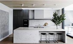 Scandinavian kitchen design featuring marble | wood accents | monochrome