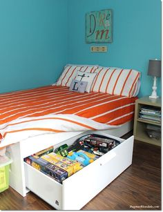 IKEA Bedroom Makeover that added a ton of storage to this  kids bedroom! DagmarBleasdale.com #bedroom #makeover #IKEA #kidsroom #storage #frugal #bed #turquoise