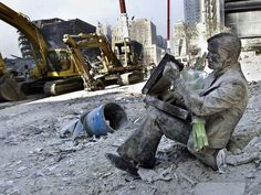 An unidentified man caked in dust and dirt from the debris after the 9/11 attacks in New York City.