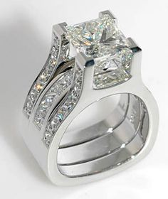 Platinum Interlace design by Coffin & Trout Fine Jewelers. The center 4 carat Princess cut shows off so nicely. Diamond Rings, Diamond Engagement Rings, Diamond Jewelry, Jewelry Rings, Jewelry Accessories, Jewellery, Wedding Jewelry, Wedding Rings, Luxury Jewelry