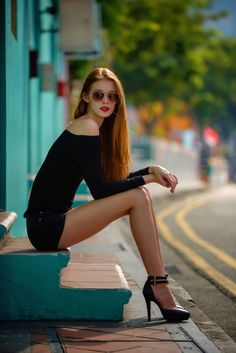 Women with long legs, high hills  and short look so attractive.