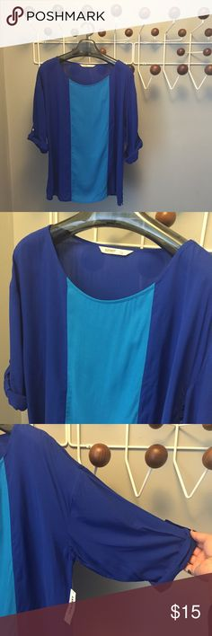 ❄️WINTER SALE❄️Old Navy colorblock 3/4 sleeve top BRAND NEW WITH TAGS! Old Navy color block top 🔵💧🔵with 3/4 button-tab rolled sleeves. Royal blue overall with a turquoise panel in the front. Very flattering placement. 100% rayon.  Size L. Check out my closet for other deals on L and XL clothing! Old Navy Tops Blouses