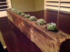 railroad tie planter - I might put candles or solar lights in the 'pots'