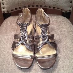 ENZO Angiolini silver leather sandals . ENZO Angiolini gently used silver leather sandals. Size 8. Enzo Angiolini Shoes Sandals