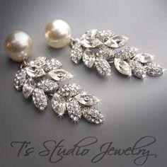 Hey, j'ai trouvé ce super article sur Etsy, chez https://www.etsy.com/ca-fr/listing/62515857/wedding-pearl-bridal-chandelier-earrings