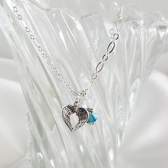 Double angel wing necklace with Swarovski Crystals. www.kaylynndesigns.com #angelwings #handmadejewelry Angel Wing Necklace, Affordable Jewelry, Swarovski Crystals, Wings, Handmade Jewelry, Silver, Design, Money, Design Comics