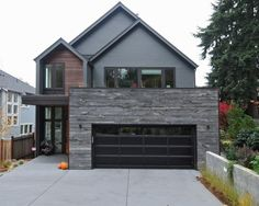 Exterior Design, Contemporary House Facade With Black Modern Garage Door Also Gray And Brown Wooden Bedboard Wall House Design Also Untreated Wooden Wall Accent Also Gray Concrete Floor And Modern Windows Design: Exciting Modern Garage Door for Your Home